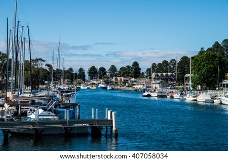 Boats moored on the Moyne River in Port Fairy, a popular seaside fishing and holiday town in Victoria, Australia.