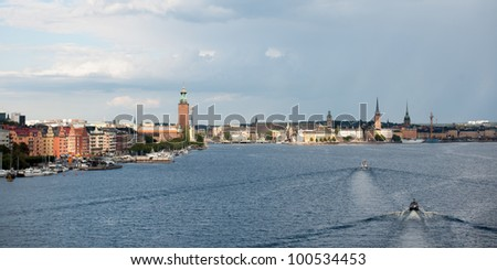 Boats moving in the bay with buildings in the background, Stockholm Town Hall, Riddarfjarden, Stockholm, Sweden