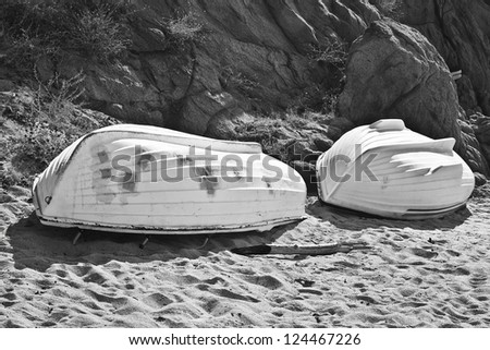 Boats near the beach in the morning; in black and white