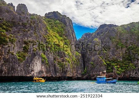 Boats near the islands in Andaman sea near Phi Phi islands. Thailand - stock photo