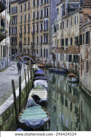 Boats on a Canal in Venice, Italy - stock photo