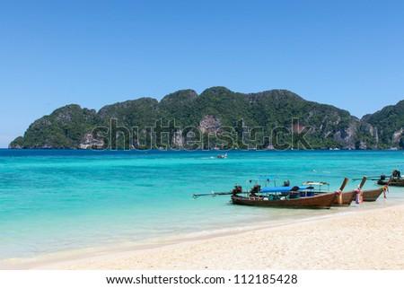 Boats on Phi Phi island beach, Thailand - stock photo