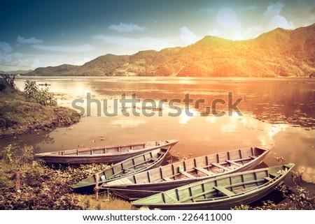 Boats on Pokhara Fewa Lake in Nepal - stock photo
