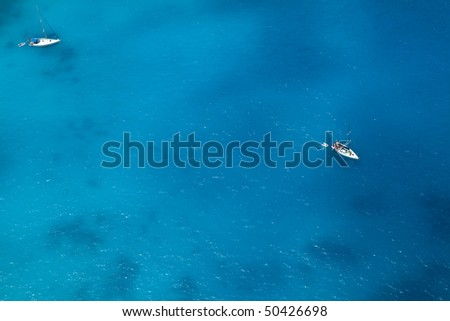 Boats on sea - top view with a lot of blue copy space