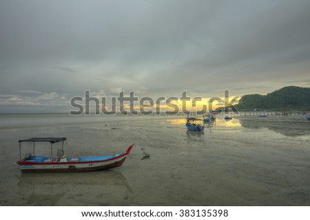 Boats on shore during low tide - stock photo