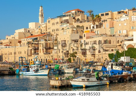 Boats on small harbor and old houses in Jaffa, Israel.