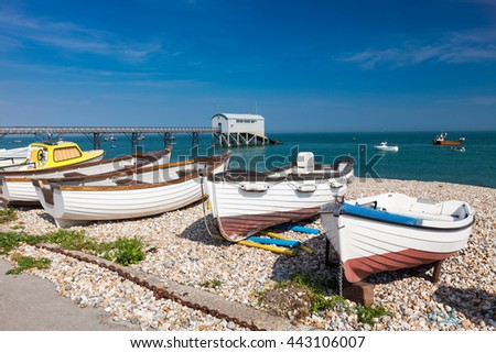 Boats on the shingle beach at Selsey Bill West Sussex England UK Europe