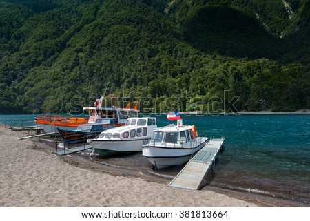 Boats on the shore of Lake Todos Los Santos, X Region, Chile