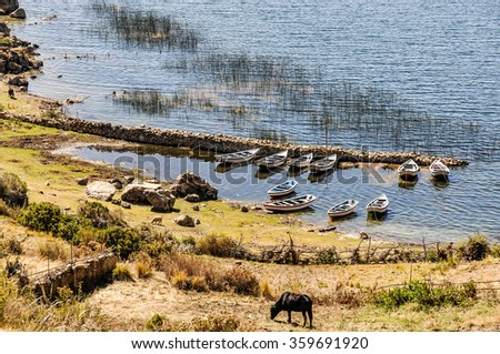 Boats on the shore on the Isla del Sol on the Lake Titicaca in Bolivia - stock photo