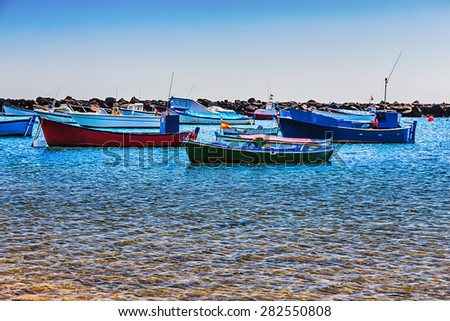 Boats on the water with waves in harbor or port - stock photo