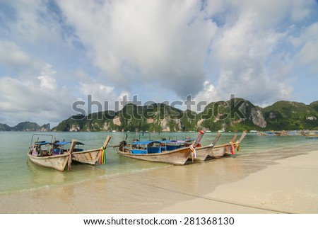 Boats used for transporting tourists parked on Thailand Island