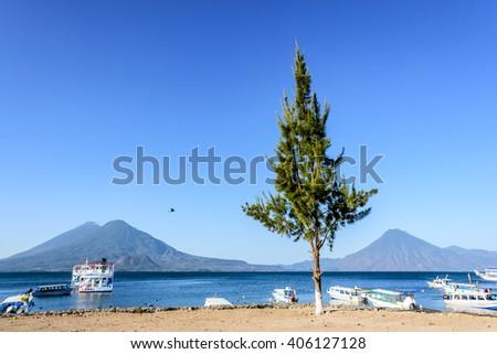 Boats & volcanoes: Atitlan, Toliman & San Pedro, at Lake Atitlan, Guatemala. - stock photo