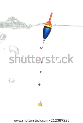 Bobber and corn on the hook as bait in the water - stock photo