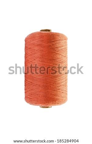 Bobbin of orange cotton threads isolated over white - stock photo
