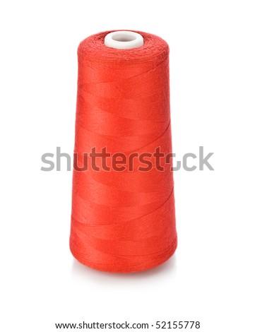 Bobbin of red thread - stock photo
