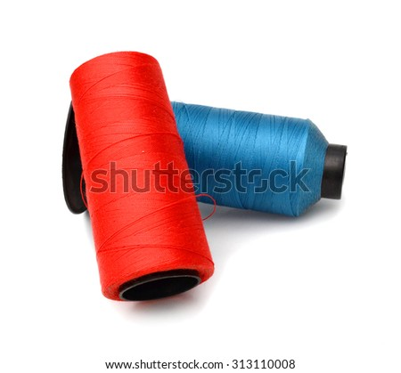 Bobbins of thread isolated on white background - stock photo