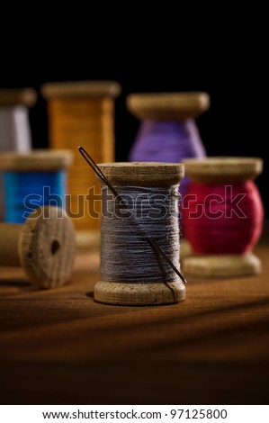 bobbins with sewing treads - stock photo