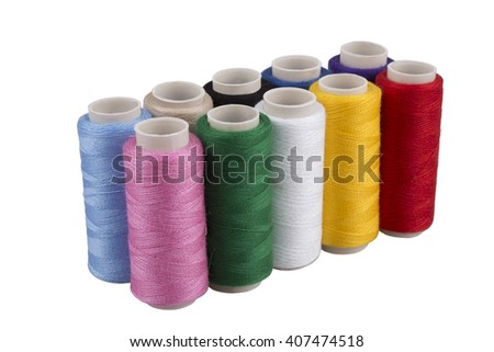 Bobbins with threads of different colors close up isolated on white background - stock photo