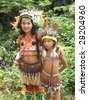 BOCA DE VALERIA: MARCH 11: Two young Indian girls are encountered in the rain forest on the Amazon River on March  11, 2009, in Brazil - stock photo