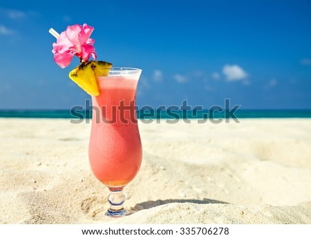 Bocal of cocktail is on sandy coral  beach, Maldives, The Indian Ocean