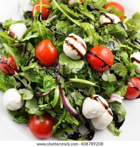 Bocconcini, cherry tomatoes, red onion and arugula salad