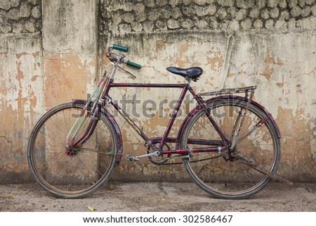 BODH GAYA, BIHAR, INDIA - July 9, 2015: Traditional Indian bicycle parked in corner of street. Bicycles are very common means of transportation on India's streets.