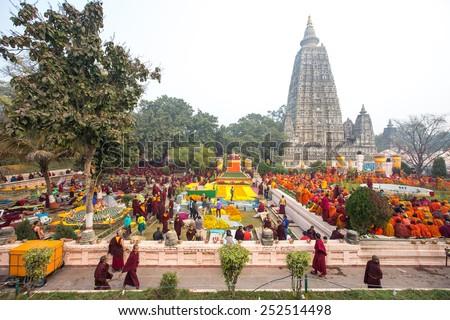 Bodhigaya, Bihar, India - January 26 , 2015: Buddhist monks sitting under the bodhi tree at Mahabodhi temple in Bodhigaya, Bihar, India.  - stock photo