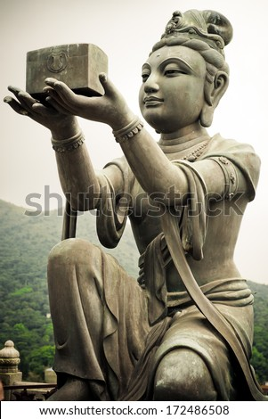 Bodhisattvas offering gift to Buddha - from Tian Tan Buddha Lantau Island, Hong Kong - stock photo
