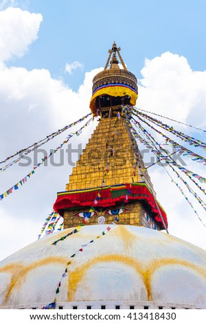 Bodhnath stupa in Kathmandu with buddha eyes and prayer flags on clear blue sky background, Nepal 2014 - stock photo