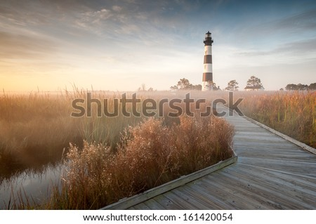Bodie Island Lighthouse Foggy Boardwalk OBX Cape Hatteras North Carolina in Autumn - stock photo
