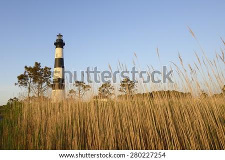 Bodie Lighthouse and Salt Marsh Grass - stock photo