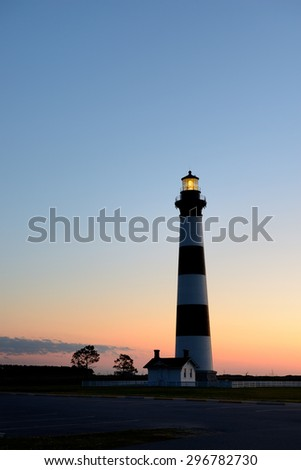 Bodie Lighthouse on the Outer Banks at Sunrise - stock photo