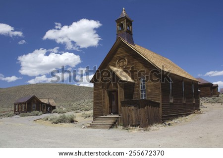 Bodie, USA - August 9, 2013: Bodie is the best preserved ghost town in California, an original mining town from the late 1800's. Wooden Church detail - stock photo