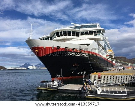 "BODO, NORWAY - APRIL 6, 2016 : The Hurtigruten ship ""MS Trollfjord"" in Bodo Harbour, Norway. Hurtigruten is an Norwegian passenger and freight line with daily sailings along the Norwegian coast."