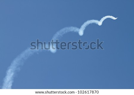 "BODRUM, MUGLA, TURKEY - APRIL 28: Turkish Air Force Demonstration Team ""Turkish Stars"" performs during their 20th foundation anniversary celebrations on April 28, 2012 in Bodrum, Mugla, Turkey"