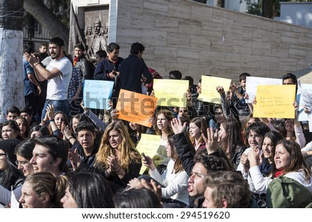 BODRUM,TURKEY-MARCH 12, 2014: Young students protesting the killing of Berkin Elvan, the child victim of Gezi Protests. 16-year-old Berkin was shot dead by the Police forces. Taken on March 12, 2014 - stock photo
