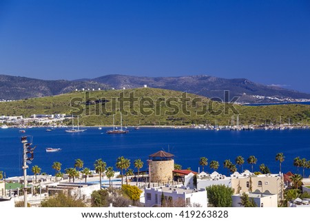 Bodrum, Turkey - May 10, 2016 - Sunset view of Bodrum town located on the Aegean coatline of Turkey, famous for summer attractions, windmills and nightlife. Turkish Riviera on May 10, 2016. - stock photo
