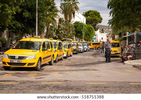 BODRUM, TURKEY - SEPTEMBER 20, 2016 ; Taxi stop. Drivers waiting for passengers and drink Turkish Tea. The taxi drivers have a break. when wireless