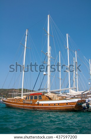 BODRUM, TURKEY - SEPTEMBER 10, 2015: Yacht and sailing vessels anchored in Bodrum Marina. Mugla, Turkey