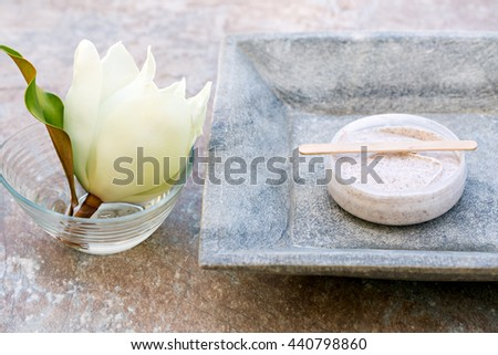 Body and face scrub and magnolia flower
