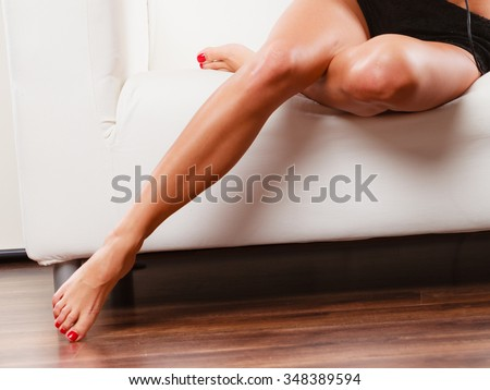 Body and skin care of female. Beauty long perfect legs of woman girl indoor. Depilation idea. - stock photo