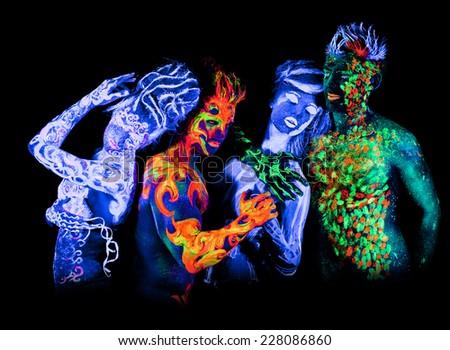Body art glowing in ultraviolet light - stock photo