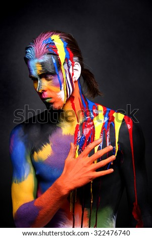 Body Art of a Man Painted With Holi Colors - stock photo