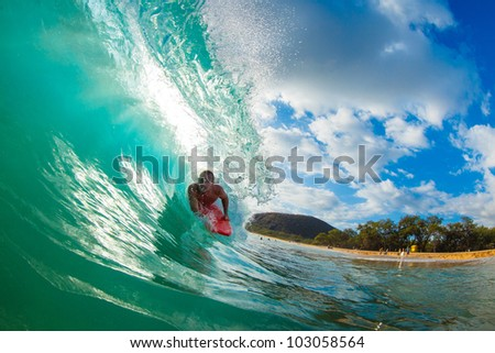 Body Boarder Surfing Blue Ocean Wave - stock photo