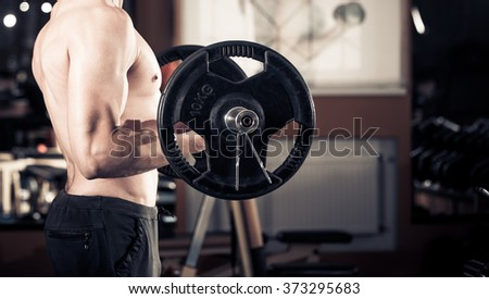 body builder with barbell in hands
