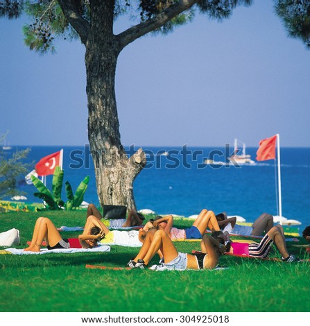 Body exercise on the grass - stock photo