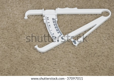 Body Fat Content Measuring Device to Indicate Body Fat - stock photo