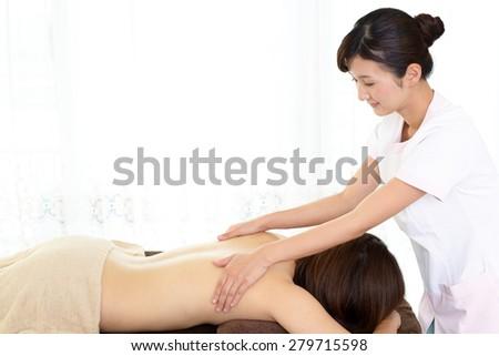 Body massage at spa salon - stock photo