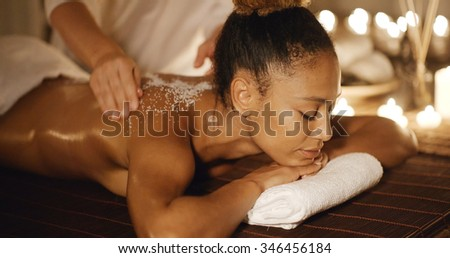 Body massage with marine salt in a spa in slow motion