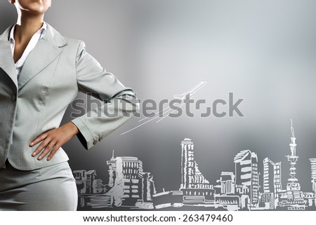Body of businesswoman against business strategy sketches